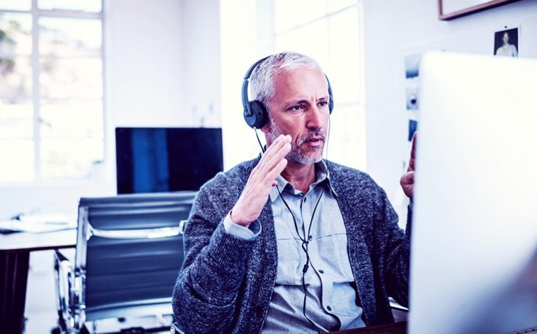 man talking to someone on his computer