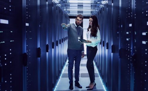 man and woman in a data centre
